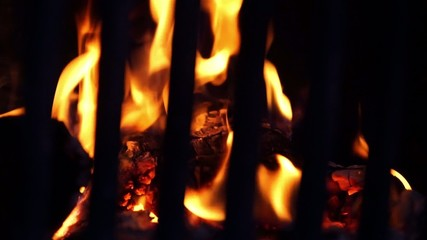 view of the blazing fire in the fireplace