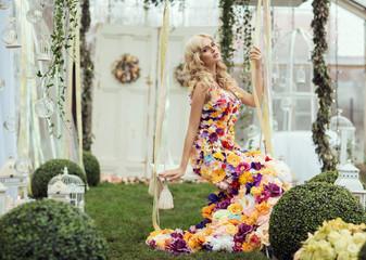 Fashion lady in spring scenery wearing flower dress