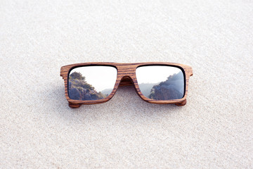 double exposure of wooden sunglasses and mountains
