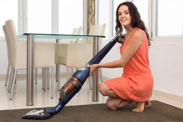Girl vacuuming living room