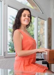 positive girl having piano class