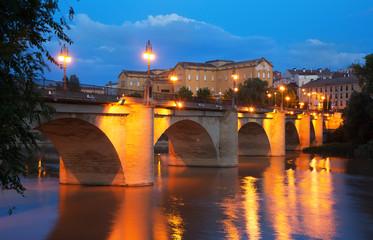 Old bridge   over Ebro river in night. Logrono