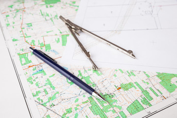 geodesy concept with pencil and calipers