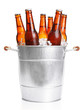 Leinwandbild Motiv Glass bottles of beer in metal bucket isolated on white