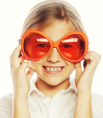 happy little girl with fun orange carnaval glasses