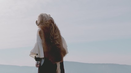 Female Druid standing on mountain