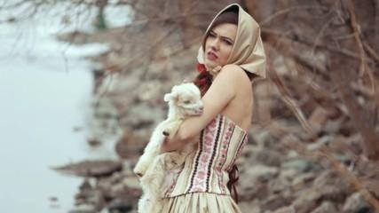 Cute brunette holding a little goat