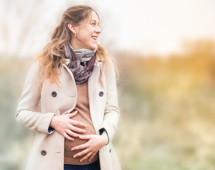happy pregnant woman at outdoor