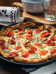 Quiche with soft cheese, artichokes and cherry tomatoes