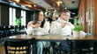 Unhappy couple sitting in the restaurant after quarrel