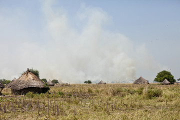 African village and grassfires