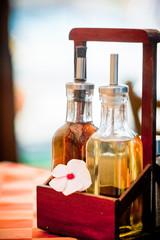 bottles of vinegar and olive oil on restaurant table