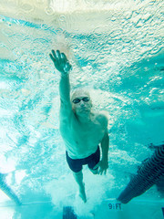 older senior swimmer underwater
