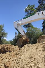 Shovel of a Excavator against a blue sky