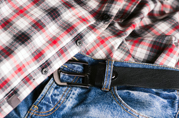 Plaid shirt and pair of jeans. Vintage stylized.