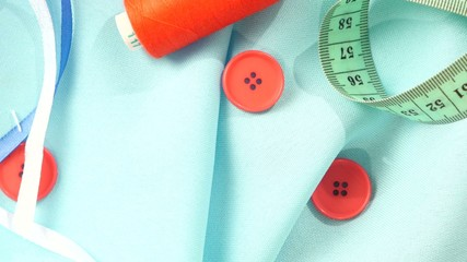 Sewing stuff like different buttons, thread, cloth, blue and