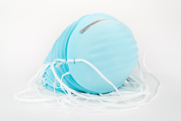 Stack of Blue, Disposable, Protective Dust Masks .
