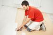 Parquet Floor worker with wood board
