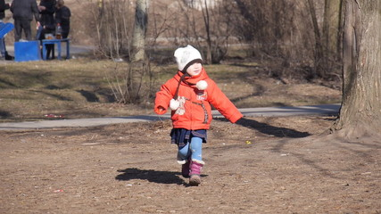 A child walks in the park, early spring, slowing