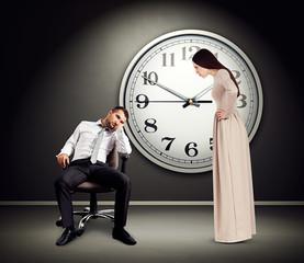 angry woman staring at lazy man