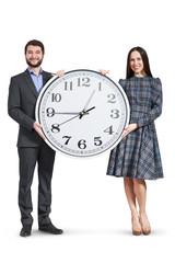 happy couple holding big clock
