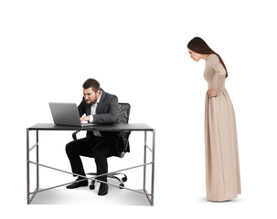 woman staring at businessman with laptop