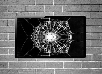 Blank screen LCD tv with broken screen hanging on a wall