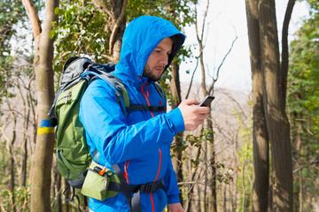 Hiker using Mobile phone