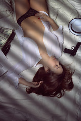 Hot woman with gun and suitcase full of money