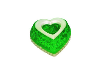soap as a green heart on a white background