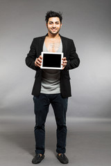 Man with digital touch screen over grey background