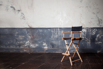 folding high chair at the wall, vintage background