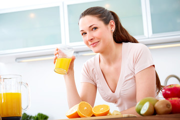Portrait of young woman with orange Juice