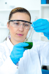 female researcher with glass equipment in the lab