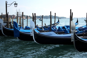 Traditional gondolas in the sea, symbol of Venice.