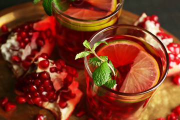 Pomegranate drink in glasses with mint
