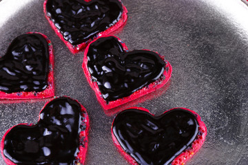 Cookies in form of heart covered chocolate