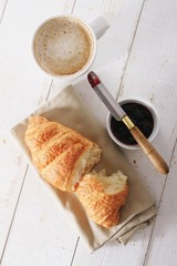fresh baked croissant with coffee
