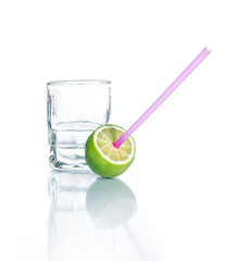 Cold drink with lime and drinking straw
