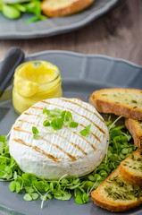 Grilled camembert with herbs, baquettes