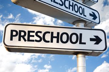Preschool direction sign on sky background