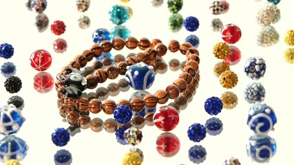 Different colorful beads on white background, cam moves to the