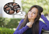 Pensive Woman with Chocolate Candy Inside Thought Bubble