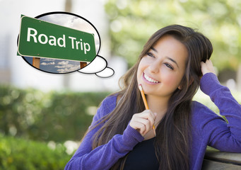 Young Woman with Thought Bubble of Road Trips Green Sign