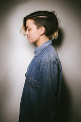 Profile of a girl in a denim shirt