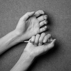 woman hand and drug Syringe