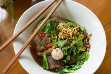 steamed pork noodle in white bowl