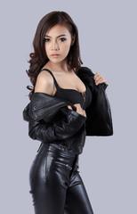beautiful female model wearing a leather dress