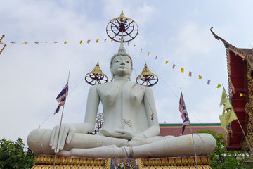 white buddha statue with sky background