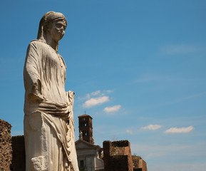 Marble statue of a woman at the Temple of the Vestal Virgins